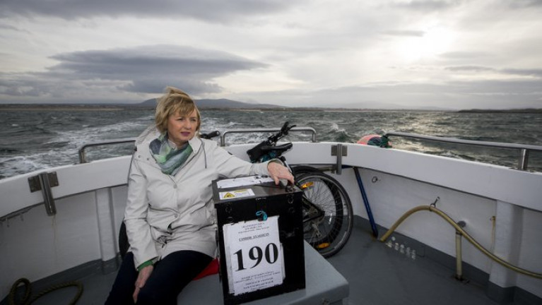 Island residents off Galway, Mayo and Donegal cast their votes in the 2020 General Election. Above Presiding officer Nancy Sharkey with a ballot box on the ferry for Gola Island off Donegal.
