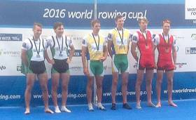 Gary and Paul O'Donovan on podium with their silver medals beside South Africa (gold) and Belgium (bronze).