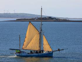 Ilen in search of wind as she heads seaward past Scattery Island in the Shannon Estuary