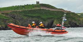 Crosshaven RNLI Inshore lifeboat speeds past Roches Point at the entrance to Cork Harbour