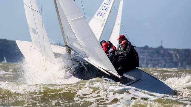 Fully powered up, punching through the Solent chop – big breeze arrived for today's Etchells World Championship race