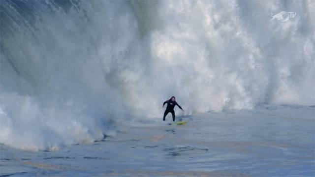 Andrew Cotton rides the big swell at Nazaré in Portugal in 2014