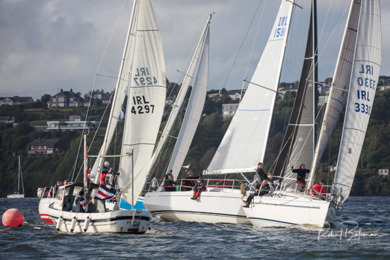 The race had an all-in start with the first gun at 6.25 pm off the Charles Fort line. Scroll down for a photo slideshow