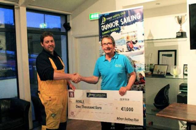 Mayo Sailing Club Commodore Duncan Sclare handing the cheque to Dave Curtis, RNLI