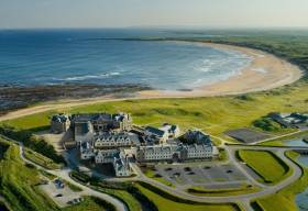 Doughmore beach seen beyond the Trump International Golf Links & Hotel in Doonbeg