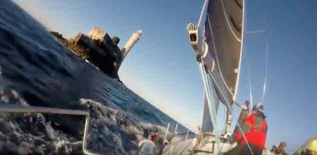 View from the rail of Jedi as the winning sailing school yacht rounds the Famous rock in this year's Fastnet Race. Scroll down for the video