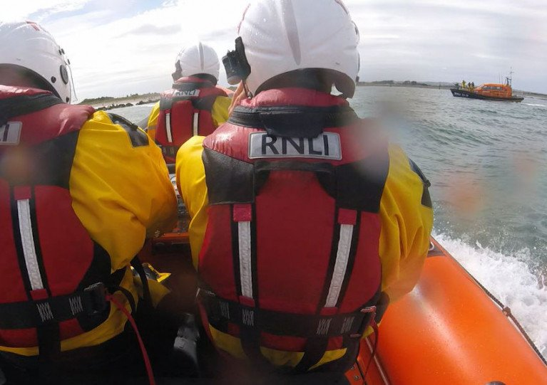 RNLI lifeboat crews from Skerries and (right) Clogherhead arriving on scene at Mornington Beach