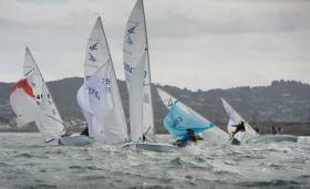 A sudden gust at the gybe mark hits the World Championship Flying Fifteen fleet in today's second race on Dublin Bay