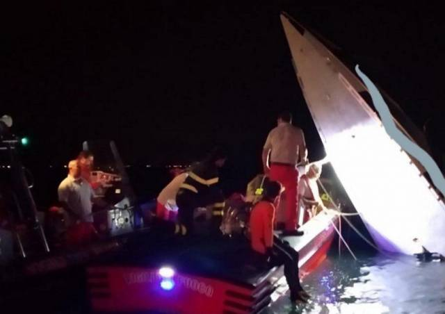 Rescue workers at the powerboat which crashed in Venice last night, killing Fabio Buzzi and two other pilots