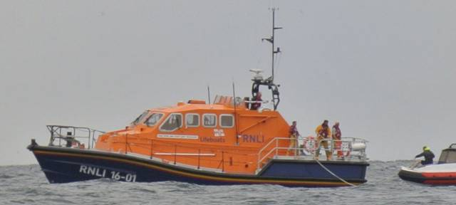 Baltimore RNLI's all-weather lifeboat crew tows a RIB with two on board to safety