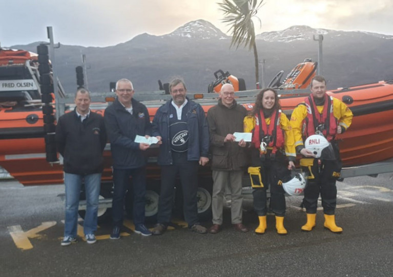 Portree and Kyle of Lochalsh volunteers receive their cheques in front of Kyle's inshore Atlantic 85, Spirit of Fred Olsen