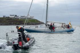 RCYC's Kieran O'Connell (in RIB) assists Winter league competitor Blue Oyster that went aground yesterday in Cork Harbour. Race three photo gallery below