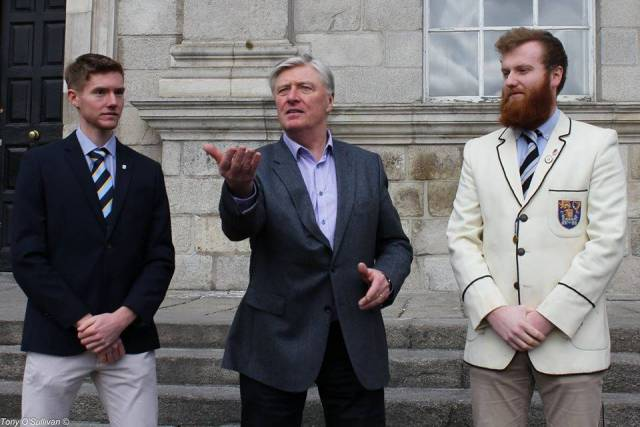Shane Mulvaney (UCD), Pat Kenny and Conor Ryan (Trinity) at the coin toss for stations.