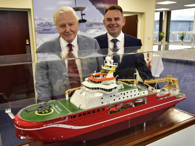 Sir David Attenborough and Cammell Laird CEO John Syvret with a model of the newbuild polar research ship currently under construction at the shipyard in Birkenhead, Merseyside