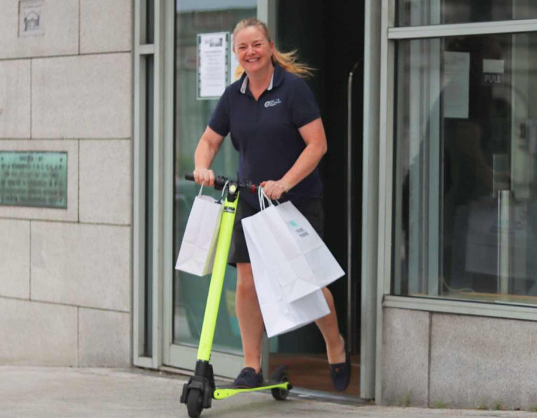 Viking Marine's Antonia with a batch of customer orders for delivery on the shop's electric scooter