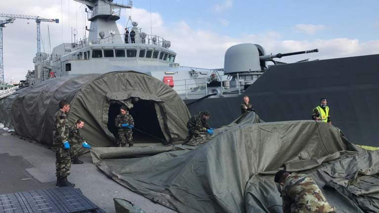 A tented field hospital beside the Naval patrol ship, LE William Butler Yeats in Galway Docks