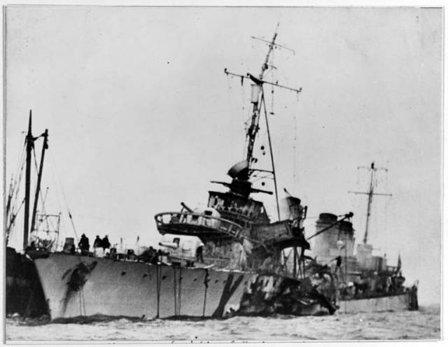 French Destroyer 'Maillé Brézé' afire and sinking at Greenock, Scotland, on 30 April 1940, after the accidental launching of one of her torpedoes