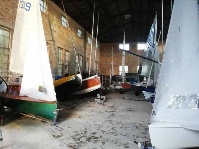 GP14s stored in the LEYC boat shed with their sails still up....