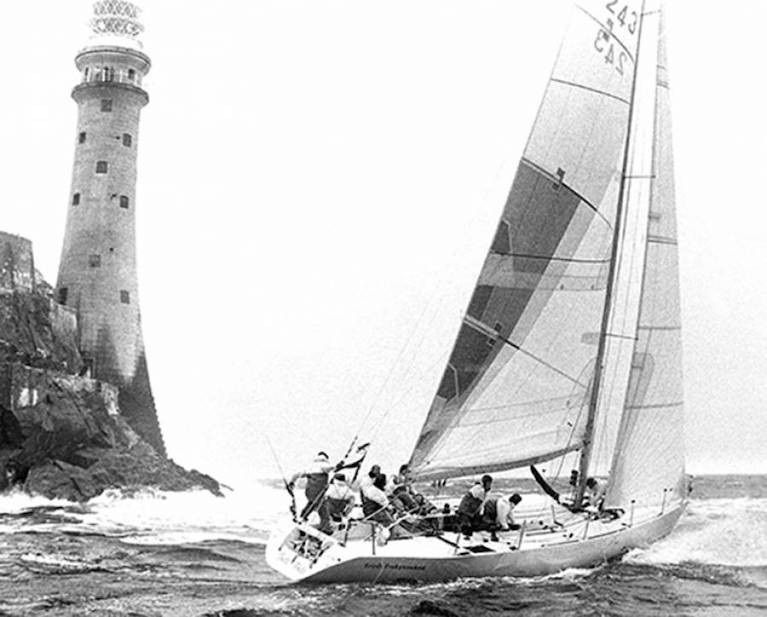 The Dubois 40 Irish Independent with Tim Goodbody as lead helm rounds the Fastnet Rock in August 1987, on the way to overall victory in the Fastnet Race. Tonight, Tim's son Richard and grandson Max will be racing rounding the Rock as crewmembers on Chris Power Smith's J/122 Aurelia in the Fastnet 450.