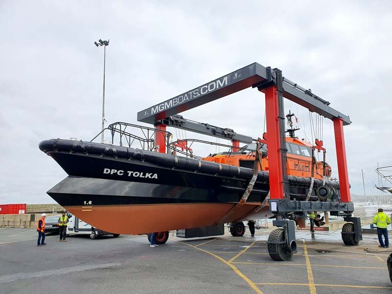 Dublin Pilot boat Tolka's underwater hull shape is clearly visible on the MGM Boats Travel Hoist at Dun Laoghaire. The vessel's ability to handle high speeds in bad weather is due to an innovative beak bow design which can steady the hull of the boat as it pitches into the sea.