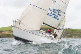 South Coast cruiser-racer Slack Alice competing in big seas of Kinsale