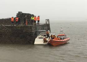 Youghal's lifeboat volunteers tie the pleasure craft to the pier head in the harbour