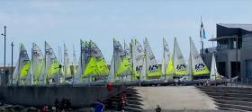 Part of the 38–boat fleet of RS Fevas waiting for wind on the second day of the National Championships at Greystones Sailing Club in County Wicklow