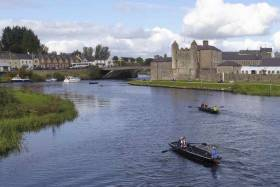 Two Lough Erne Cots racing with Enniskillen Castle in the background