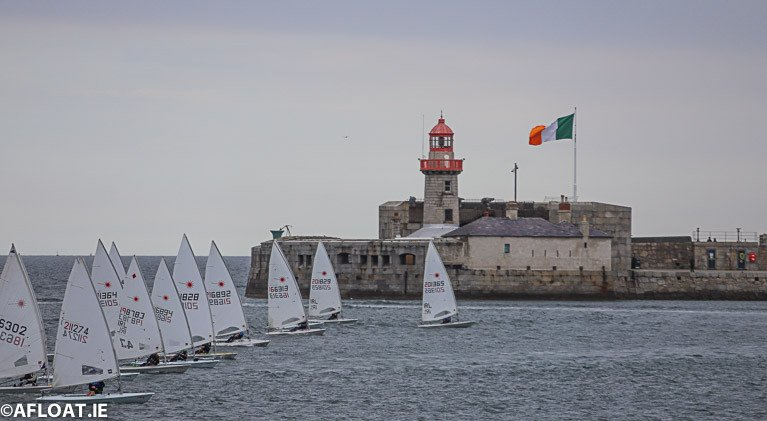 The DBSC Laser 4.7 fleet race past Dun Laoghaire's East Pier