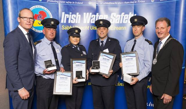 Simon Coveney TD, Minister for Housing, Planning & Local Government with 'Seiko Just In Time Award' recipients Sergeant Kieran O Regan, Gardai Claire Murphy, Mark Holden, Kieran Hayes (Tipperary) and Martin O'Sullivan, Chairman of Irish Water Safety at the annual Irish Water Safety Awards held at Dublin Castle.