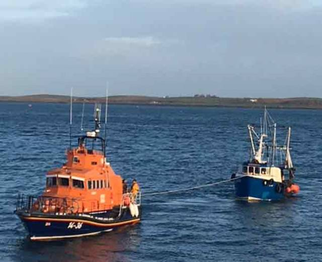 Donaghadee all-weather lifeboat Saxon towing rescued fishing vessel