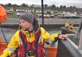 Volunteer crew member Barry Kirkpatrick training on coxswain boat handling in Ballylumford Harbour