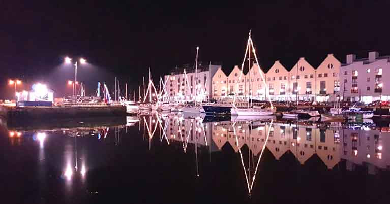 Winter Solstice 2019 with Christmas decorations in Galway Port Marina. Despite Storm Elsa less than three days earlier, the completely calm Halcyon day of midwinter arrived on cue