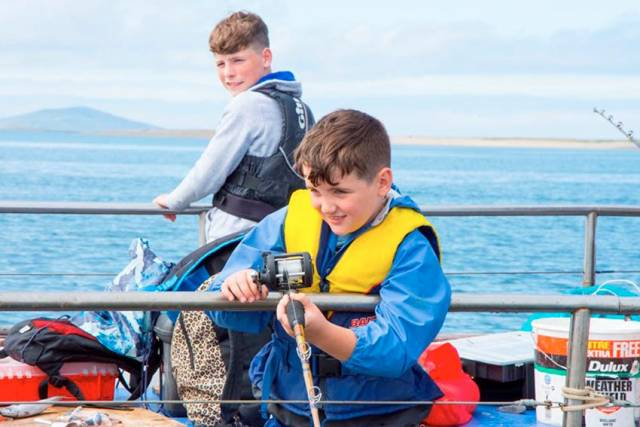 Matthew Moran and Oisin Fynes of Newport Sea Angling Club in action during a fishing trip in 2018
