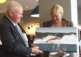 Tony Hiney (left) is presented with a canvas photograph of Clifden's new Shannon lifeboat