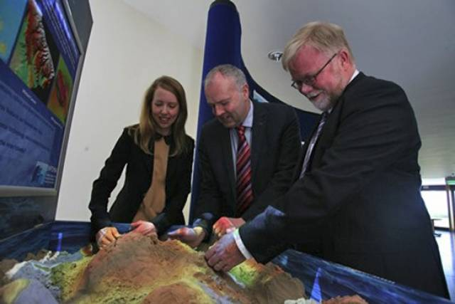 Gerald Fleming of Met Éireann with Eleanor O'Rourke and Mick Gillooly of the  Marine Institute checking out an AR sandbox, one of many interactive displays at the Marine Institute's 'Beneath Our Wild Atlantic' exhibition during SeaFest from 2-3 July