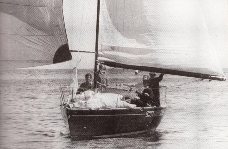 The late Bruce Lyster (on left) as his hugely successful Half Tonner Swuzzlebubble finishes first in the late August 1980 Abersoch-Howth Race to add the ISORA Championship Title to a season of national and international success