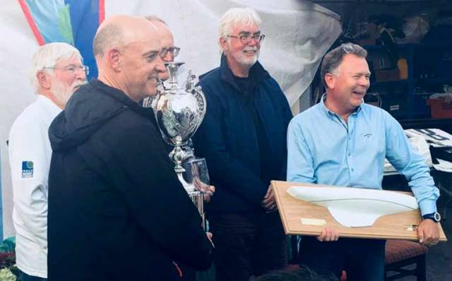 Dragon winners - Royal St George team led by Neil Hegarty (left) with Peter Bowring (partly hidden centre with trophy) and David Williams (right) with half model