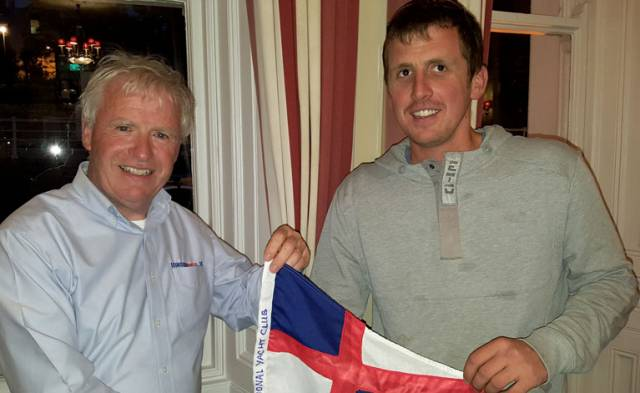 Solo sailor – NYC Commodore Ronan Beirne (left) salutes NYC member and Mini Transat entrant Tom Dolan in Dun Laoghaire