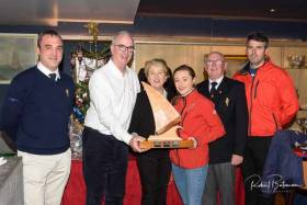 Sally O'Leary presents the Archie O'Leary Memorial Trophy to Anthony O'Leary and Sophie Browne (all in spinnaker fleet) Included are Kieran O'Connell, Rear Admiral Keelboats, Capt. Pat Farnan, RCYC Admiral and Nicholas O'Leary