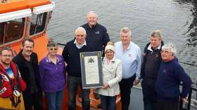 Pictured at the presentation are from left are Daniel O'Connell, Aran Islands RNLI crew member, family member Sean Flaherty, John and Mary Harwood with the vellum, Tony Hiney, RNLI Community Fundraising Manager, John O'Donnell Aran Islands RNLI Coxswain, John Mulkerrin Aran Islands RNLI mechanic and Michael Hernon, Aran Islands RNLI Lifeboat Operations Manager