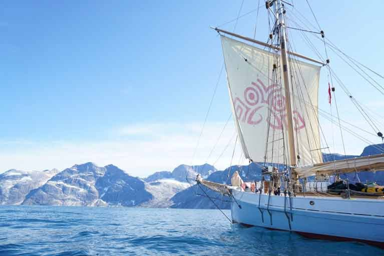 The restored Ilen in Greenland last July with her squaresail featuring the Salmons Wake logo which has become a symbol of the ship