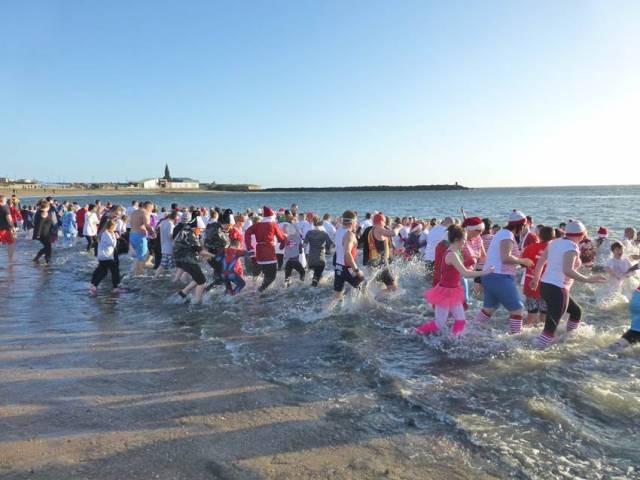 Swimmers take a festive dip in the North Sea at Newbiggin by the Sea