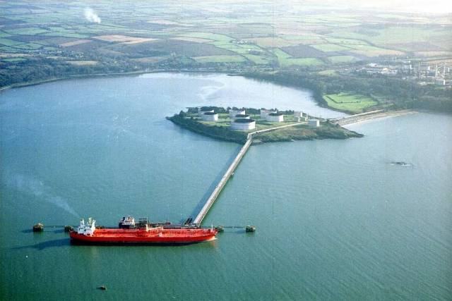 Tankers berthed at the jetty of the State's sole oil refinery at Whitegate in lower Cork Harbour has been sold to a Canadian company