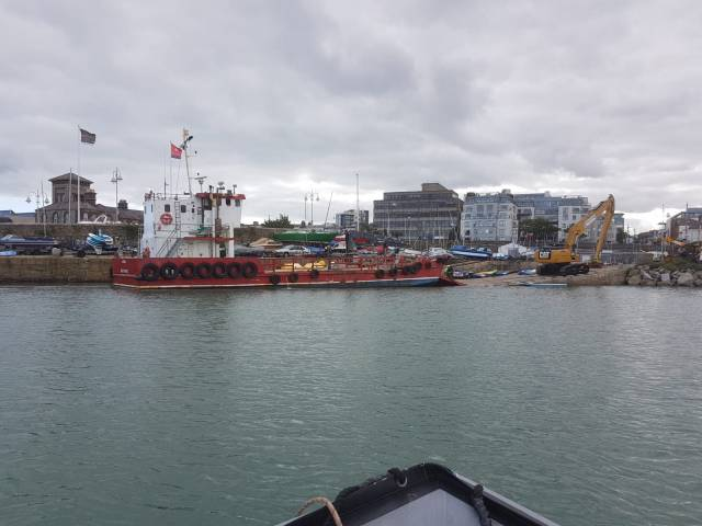 Landing Craft Assists in Works to Repair Dun Laoghaire Harbour Piers Damaged by Storm Emma