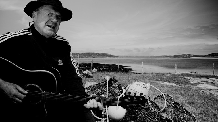 Mathematician and musician Peter Knox singing the Turbot Island song remembering the death of three fishermen in 1974 which led to the island's evacuation