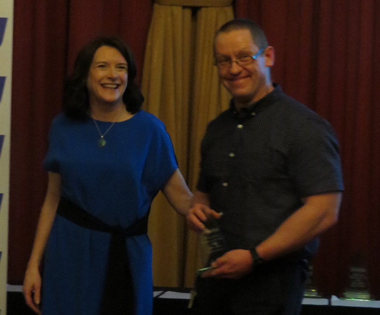 Patrick O'Leary receives his award from Miriam Malone and