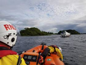 Lough Ree lifeboat volunteers approaching a motor cruiser run around earlier this week