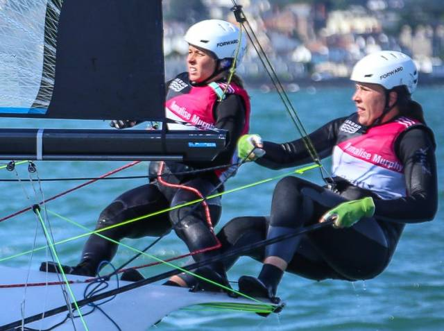 Katie Tingle (left) sailing with Annalise Murphy in the Olympic 49erFX dinghy