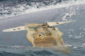 Photograph of the Cheeki Rafiki's upturned hull taken by crew of the USS Oscar Austin on 23 May 2014